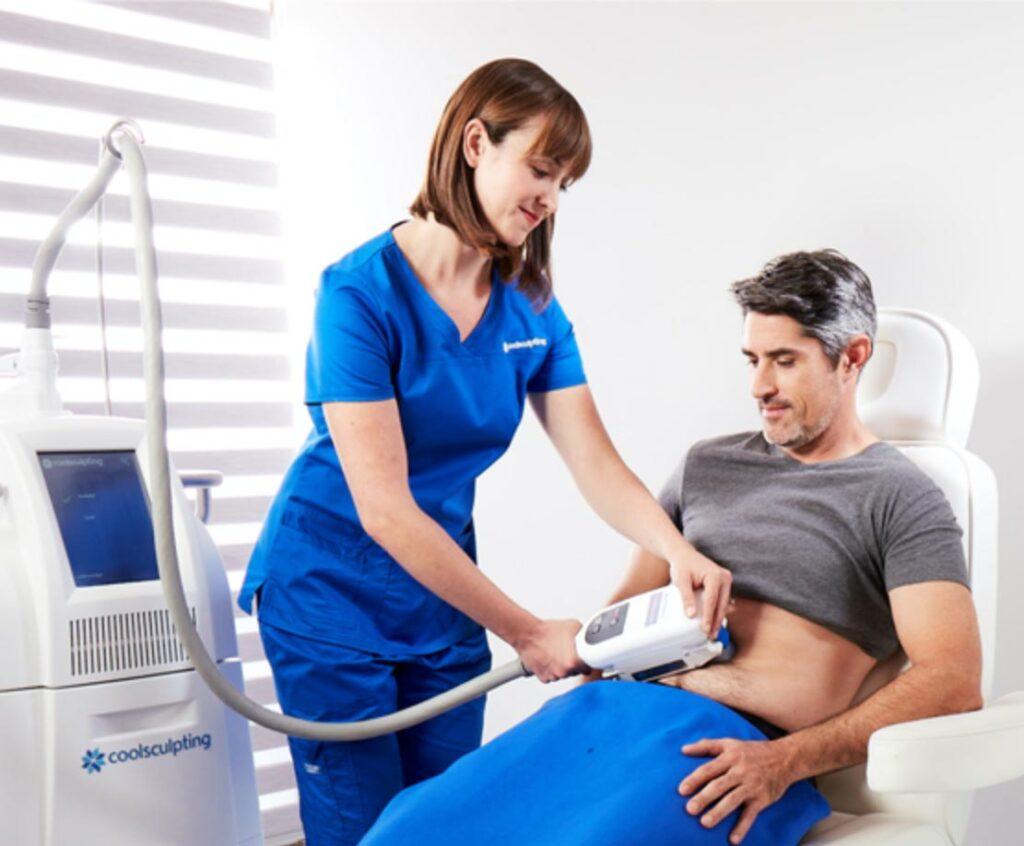 Female Surgeon Uses coolsculpting equipment for the Male patient abdomen  | Knott Street Dermatology | Coolsculpting | Portland Oregon